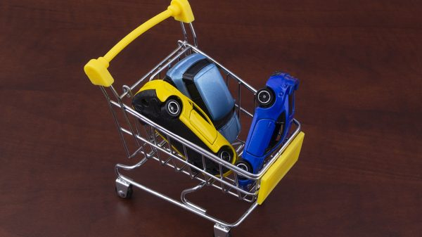 Shopping cart filled with car toys